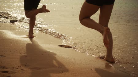 sepia : Two kids legs running at the beach, slow motion