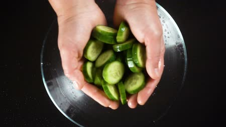 cucumber : Falling cucumber cuts in glass bowl, slow motion