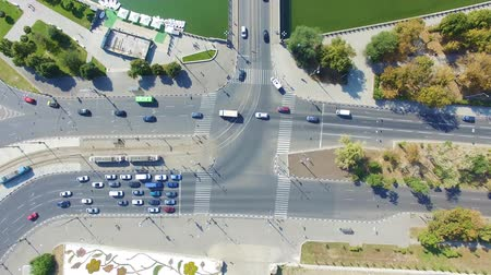 Aerial view to city crossroads with cars