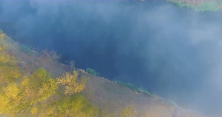 Aerial view of river under morning fog and golden trees, Ukraine Стоковые видеозаписи
