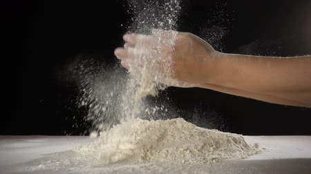 chefs hand clapping with powder flour when kneading the dough,