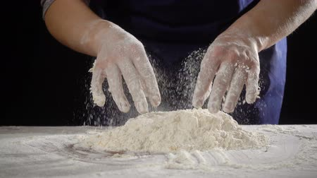 womans hands shake off the dough at kneading