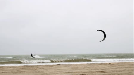 acrobata : Kite Board Surfing on Gulf of Mexico at Port Aransas Texas on a foggy day