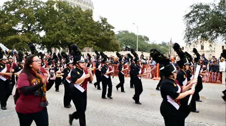 watching : San Antonio, Texas USA - February 3 2018: High school band marches past the historic Alamo during parade