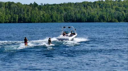 колено : Kneeboarding and speed boat on beautiful northern Minnesota lake on sunny day