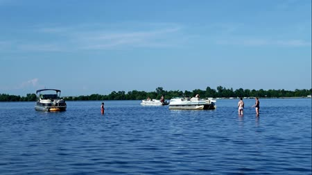 eatery : Bemidji, MN USA - June, 2018: People families arrive by boat to enjoy fun time on sandbar on Lake Irving where Mississippi River enters lake