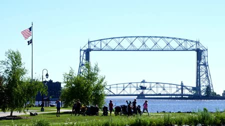arquipélago : Duluth, Minnesota - July 2, 2018: Exercise class with strollers near Duluth Minnesota Aerial Lift Bridge and Canal to Harbor on a sunny morning
