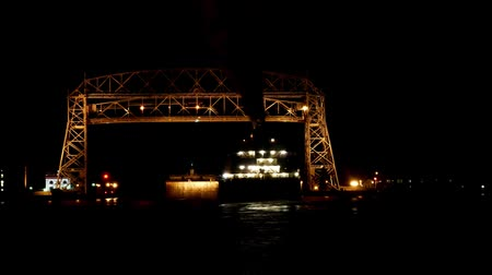 superior : Time lapse at night of two ships going under the historic aerial lift bridge in Duluth, Minnesota.