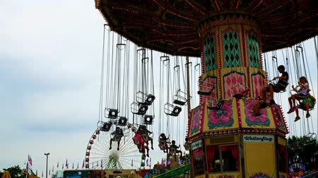 St Paul, MN - August 27, 2018: The Minnesota State fair is the largest gathering in Minnesota and millions of people attend during the two weed period. People enjoying amusement rides.