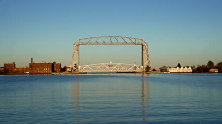 Two clips of the Iconic Duluth Minnesota Aerial Lift Bridge and Duluth Harbor on a calm sunny afternoon under blue skies. Стоковые видеозаписи
