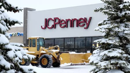 BEMIDJI, MN - 27 DEC 2018: JC Penney Retail Mall Location during a winter snow storm. JCP is an Apparel and Home Furnishing Retailer. Customers and snow plow can be seen.