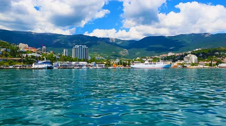 tourism : Scenic summer panorama of Black Sea pier and port harbor in Yalta, Crimea, Ukraine