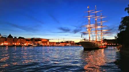 stare miasto : Scenic summer evening view of the Old Town Gamla Stan with historical tall sailing ship AF Chapman at Skeppsholmen Island in Stockholm, Sweden