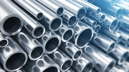 kanalizace : Creative abstract heavy metallurgical industry and industrial manufacturing business production concept: heap of shiny metal steel pipes with selective focus effect Dostupné videozáznamy