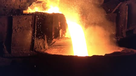 open hearth : Pouring of liquid metal from open-hearth furnace at the metallurgical plant Stock Footage