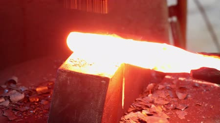 pneumatic : Shaping of red hot metal part on the anvil with a jackhammer pneumatic mallet in blacksmith workshop