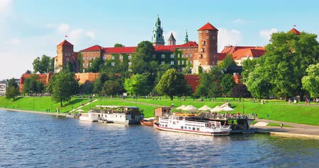 fortresses : Scenic summer view of the Wawel Castle fortress, Cathedral Church and Vistula river embankment in the Old Town of Krakow, Poland
