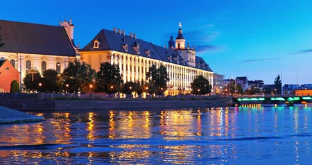 blue color : Scenic summer night view of the University building and Oder river embankment in the Old Town of Wroclaw, Poland