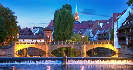 Scenic summer night view of the bridge over Pegnitz River in the Old Town of Nurnberg, Bavaria, Germany