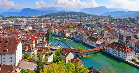 wooden bridge : Scenic summer aerial panorama of the Old Town medieval architecture in Lucerne, Switzerland Stock Footage