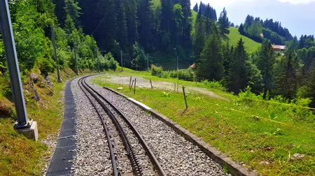 Scenic summer view of the cogwheel railway on the way to Rochers de Naye mountain peak in Switzerland Wideo