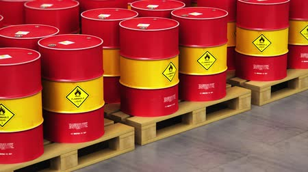 красный : Creative abstract oil and gas industry manufacturing and trading business concept: 3D render video of the group of the industrial storage warehouse with a stacked rows of red metal oil drums or petroleum barrels with selective focus effect