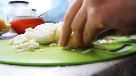 cut onions with a knife