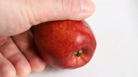 red apple cut with a knife