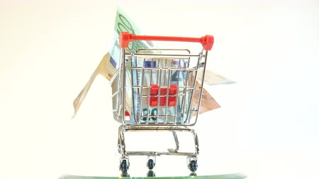 euro banknotes : Shopping cart full of euro Stock Footage