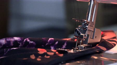 seams : the tailor sews on the sewing machine