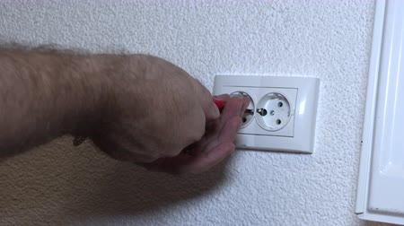 cabling : The man is repairing the outlet, cable