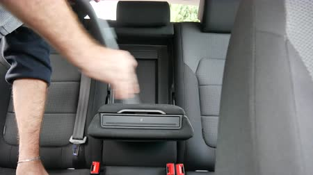 моющее средство : A man vacuums the car interior, germany