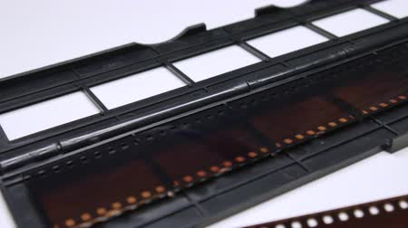 vcr : A man digitizes a camera film on a device, Analog film scanned to digital file Stock Footage