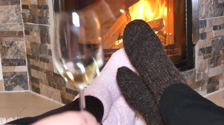hot wine : Lovers drink white wine in front of the fireplace