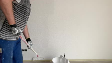 antique grunge : A man paints a wall in white Stock Footage