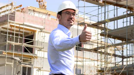 прораб : Architect at the construction site shows thumbs up
