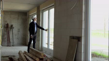 belső : Architect inspects construction from the inside
