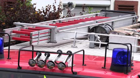 siren : Roof of a fire truck with a blue flashing light Stock Footage