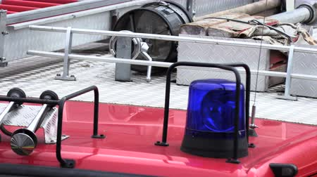 sirena : Roof of a fire truck with a blue flashing light Filmati Stock