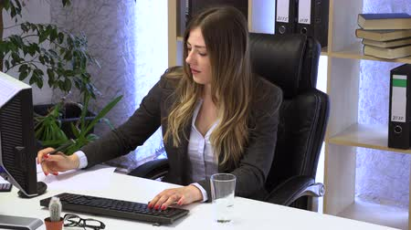 brunette manager works in the office with documents