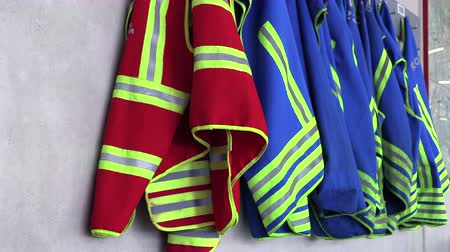 vests for firefighters hang on a hanger