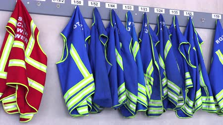busqueda y rescate : vests for firefighters hang on a hanger