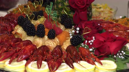 kerevit : crayfish and seafood with fruit laid out on a tray