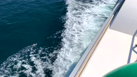 the waves behind the yacht
