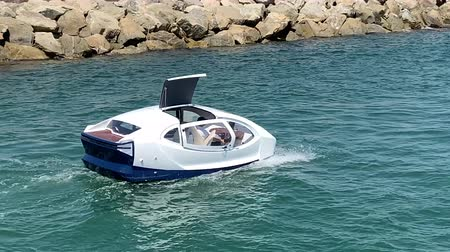 white amphibious car floating in the mediterranean sea