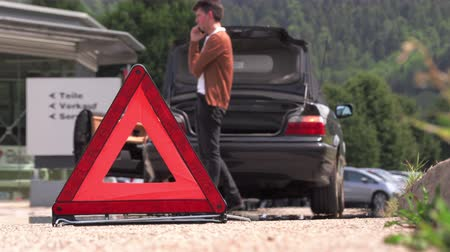 emergency stop : A young man puts an emergency sign