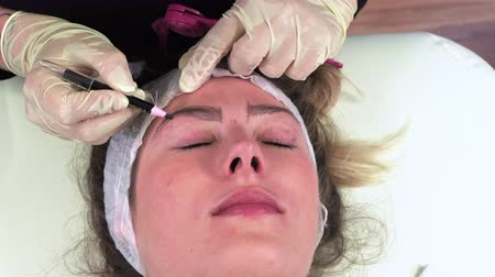 eyebrow correction : Young girl make permanent makeup. Eyebrow Microblading