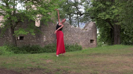 baletnica : Ballerina in a red skirt dancing on the street