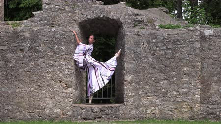 milost : Ballerina dancing in nature near the ruins of an ancient castle