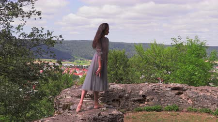 talento : Ballerina dancing on the balcony of the ruins of an old castle